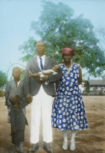 'Igbo Church Leader and Family at Calabar', unknown photographer, tinted lantern slide, ca. 1930-1940, Church of Scotland Slide and Visual Collection (CSWC47/LS9/5), Centre for the Study of World Christianity, Edinburgh.